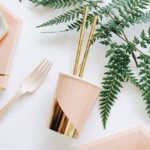 Blush and gold paper party items.