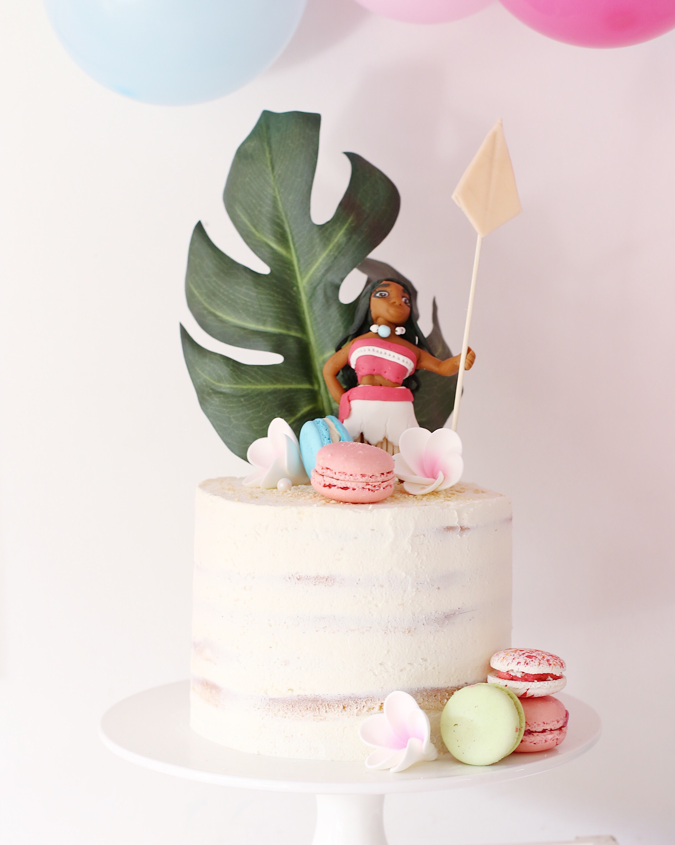 Moana party cake with macarons and Moana topper