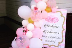 Welcome sign adorned with balloons