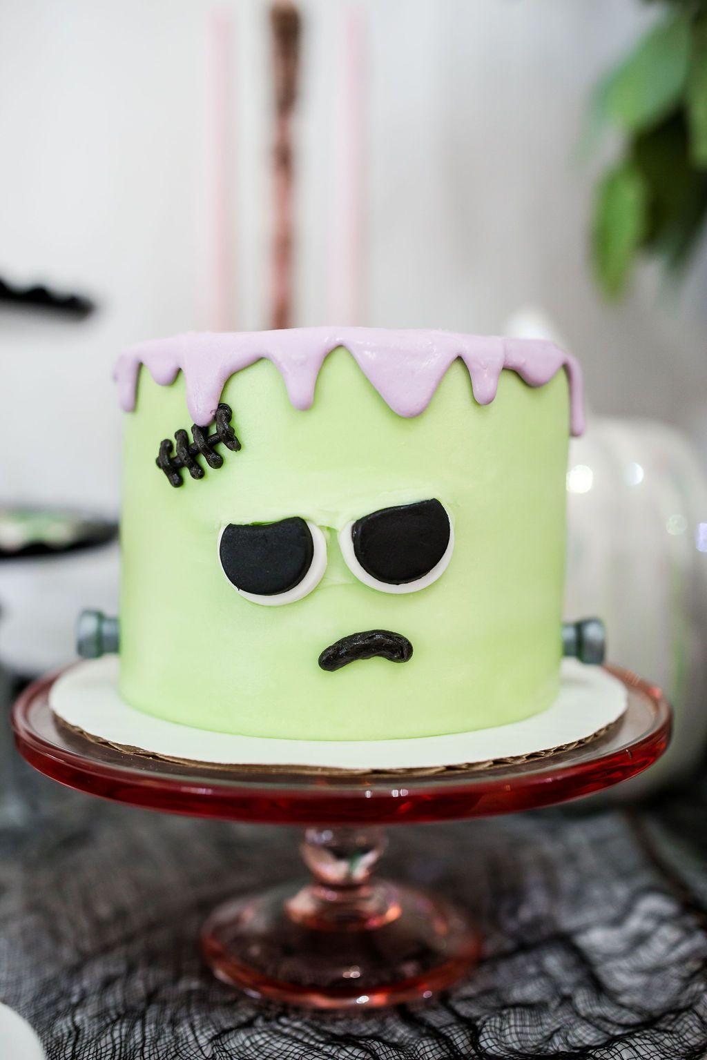 A pastel monster mash Halloween cake