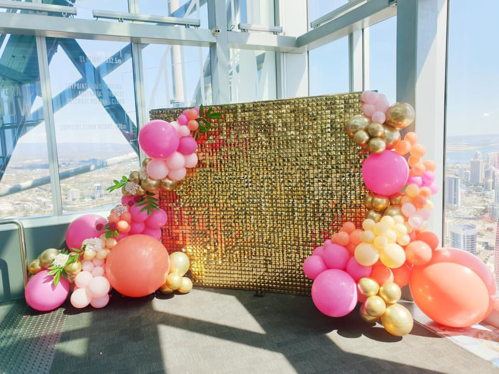Next Event's shimmer wall in action at Skypoint on the Gold Coast. Balloons by Love & Wishes Styled Events.